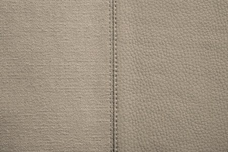 fabric textures: the stitched combination of two textures of beige color from rough fabric and an imitation leather for abstract backgrounds