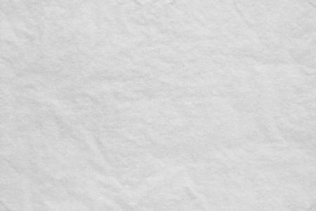 薄い丸めたティッシュ ペーパーやトレーシング ペーパーから白のテクスチャ背景 写真素材