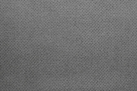 seamy: texture of leather fabric with a reverse side for empty backgrounds of black color with the punched openings