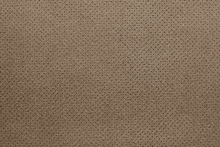 seamy: texture of leather fabric with a reverse side for empty backgrounds of brown color with the punched openings
