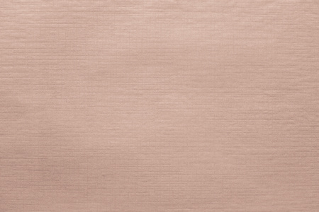 imprinted texture of blank thin glossy paper apricot color for
