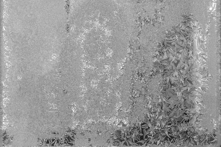 silvery: abstract textural winter patterns on the frozen glass of silvery gray color