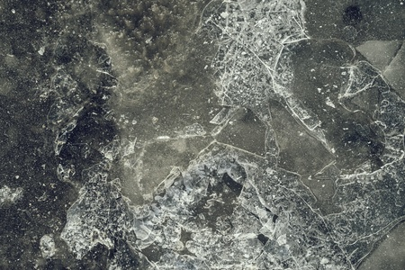 splinters: gray-green color texture of a glossy surface of ice with cracks and with splinters for abstract backgrounds
