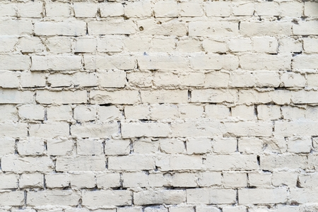 pale color: the abstract textured background of an old brick surface of pale color