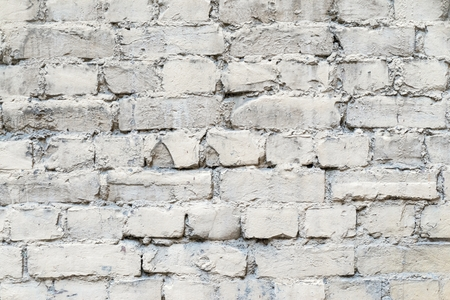 pale color: the abstract textured background of an old brick facade of pale color Stock Photo