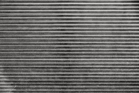 metal monochrome: monochrome abstract fragment of dirty metal blinds for the abstract textured backgrounds