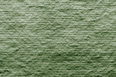 wadded: abstract texture of wadded fabric of green color for empty and pure backgrounds