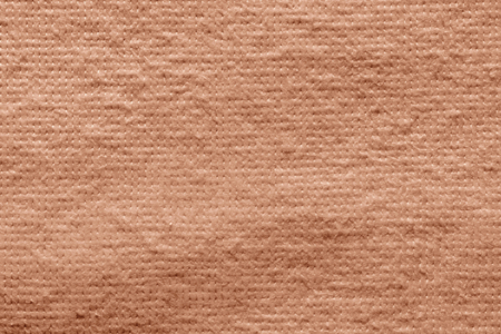wadded: texture of quilted textile batting of coral color for pure and empty backgrounds