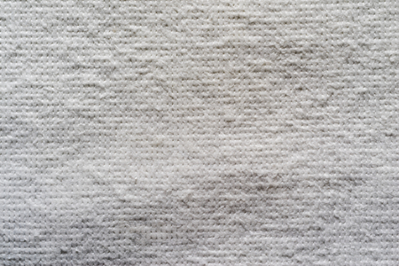 batting: texture of quilted textile batting of gray color for pure and empty backgrounds