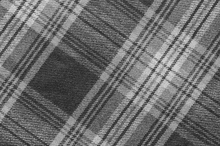 slanting: monochrome texture of woolen fabric with an slanting checkered pattern for backgrounds and for wallpaper Stock Photo