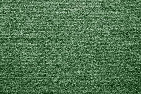 tinted: abstract textile texture of felt fabric with tinted stains of green color for empty and pure backgrounds