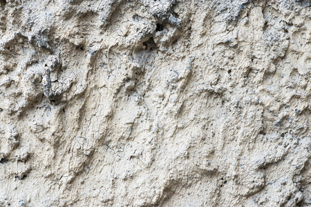 bumpy: the abstract textured background old bumpy plaster with cracks