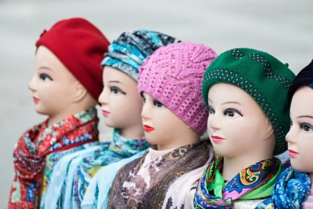 headdresses: the digital photo female dummies of the heads for of headdresses, woolen knitted caps and silk scarves Stock Photo