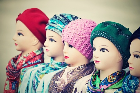 headdresses: the digital photo with a retro effect, female dummies of the heads for advertizing of headdresses, woolen knitted caps and silk scarves
