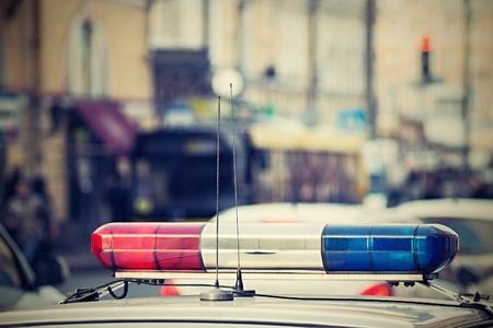 the police car patrols city streets photo