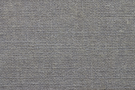 grained: grained texture of textile rough fabric of gray color for empty and pure backgrounds