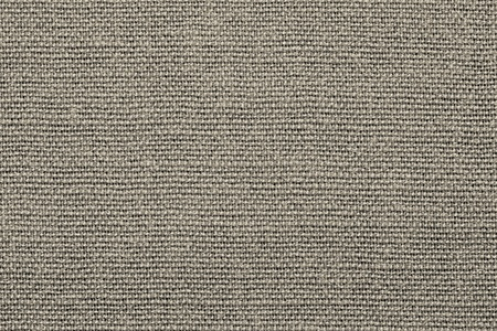 grained: grained texture of textile rough fabric of beige color for empty and pure backgrounds Stock Photo