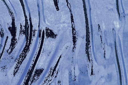 vague: the abstract wavy textured background with black spots on dirty-blue