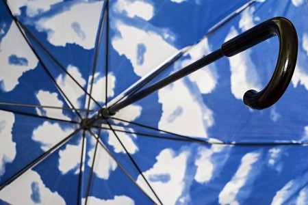 Abstract Fragment Of An Umbrella Cane From Within Closeup With A Spotty  Surface Of Blue White