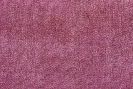grained: grained texture of textile fabric of pale crimson color for empty and pure backgrounds