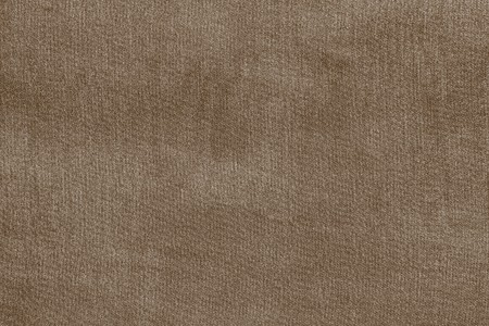 pale colour: grained texture of textile fabric of pale brown color for empty and pure backgrounds Stock Photo