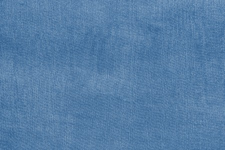 pale colour: grained texture of textile fabric of pale blue color for empty and pure backgrounds