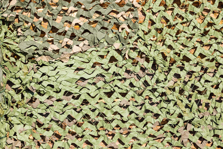 imitations: the abstract textured camouflage net for masking of green color for a military background