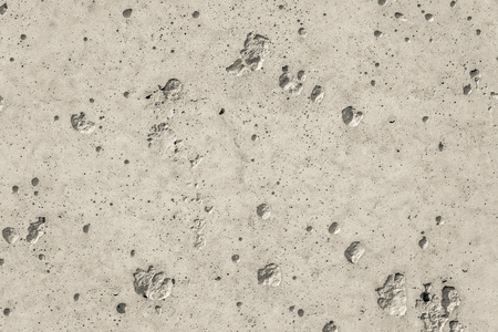 hollows: beige color texture of a concrete surface for empty and pure abstract background