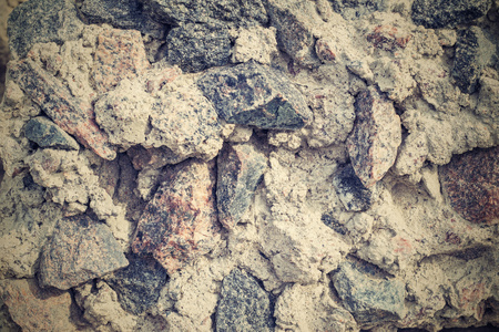 bumpy: rough and bumpy texture of crushed stone of retro color for empty and abstract backgrounds