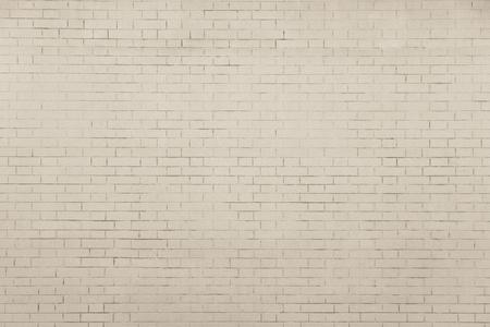 空と純粋な背景のレンガの壁の淡いベージュの織り目加工の表面 写真素材