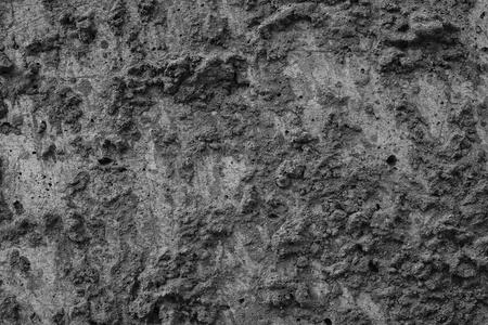 bumpy: bumpy texture of black color surface of a cement for empty and abstract backgrounds