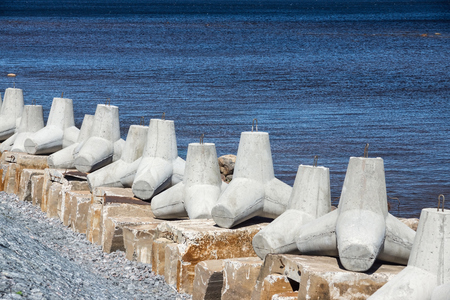 breakwaters: strengthening from concrete breakwaters on the bank of the sea gulf