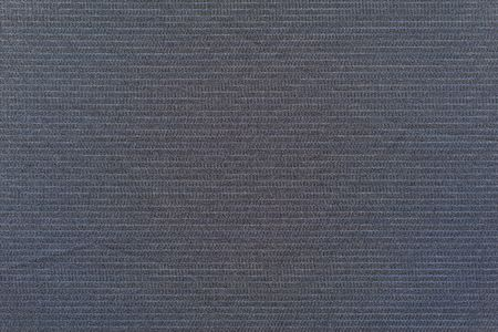 speckle: dark blue background of fabric with abstract grained texture and a thin pale strip for empty and pure layers and a place for the text Stock Photo