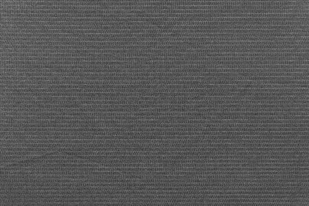 speckle: black background of fabric with abstract grained texture and a thin pale strip for empty and pure layers and a place for the text