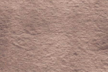 interlace: the abstract interlace textured background of dark brown rough fabric for empty and pure layers