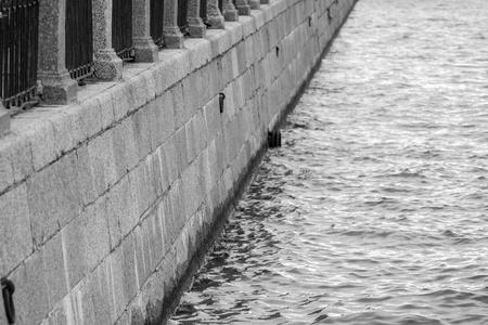 embankment: old architecture of the embankment from a stone and metal and a blank space for the text
