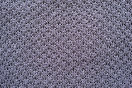 lilac background: abstract knitted honeycomb texture