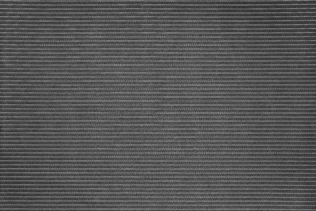 grained: black of fabric with abstract speckled grained texture and a thin strip for empty and pure background and a place for the text