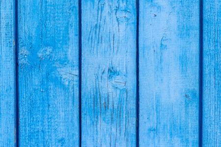 blue paint: abstract texture of old wooden boards with the exfoliating peel of blue coloring for abstract backgrounds