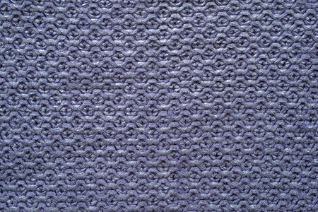violet background: abstract knitted cellular texture of violet color with the varnished dusting from synthetic threads for backgrounds and for wallpaper