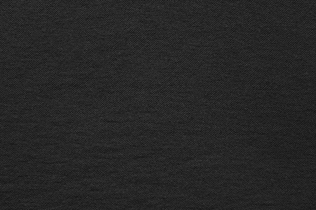 black fabric: the textured background from fabric of thin cotton material of black color and a blank space for the text