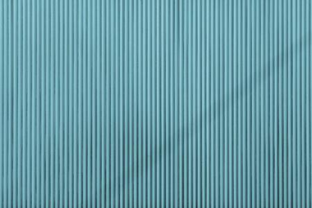 azul turqueza: de color turquesa ondulado corrugado textura de una superficie de una hoja de hierro para los fondos vac�os y puros y para el papel pintado