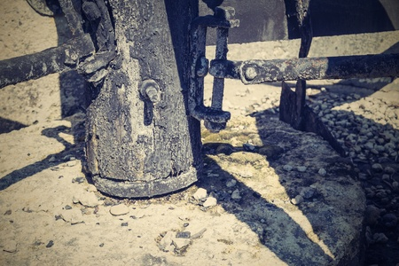 charred: abstract design of part of an ancient mill with stone millstones and the charred iron elements