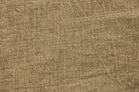 wornout: abstract texture of old worn-out denim of sepia color for backgrounds and for wallpaper