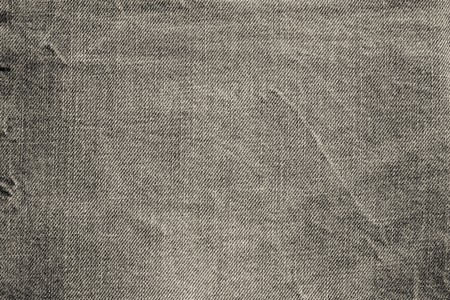 wornout: abstract texture of old worn-out denim of beige color for backgrounds and for wallpaper