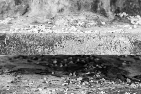 outworn: old abstract texture of an edge or end face of the charred plate against indistinct and not sharp Stock Photo