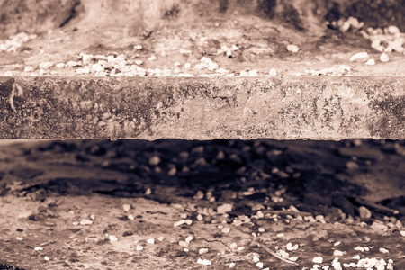 burned out: old abstract texture of an edge or end face of the charred plate against indistinct and not sharp Stock Photo