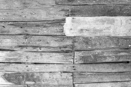 wooden partition: wall or partition from old wooden boards for the abstract textured background and for wallpaper of monochrome tone Stock Photo