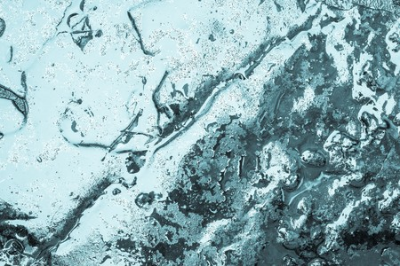 damp: abstract glossy brilliant background of turquoise color for the textured damp or wet wallpaper with water drops