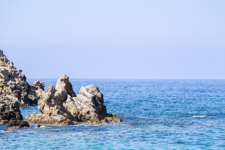 the crags: wild colourful landscape of rocky islands at the sea with the line of the horizon and a blank space for the text